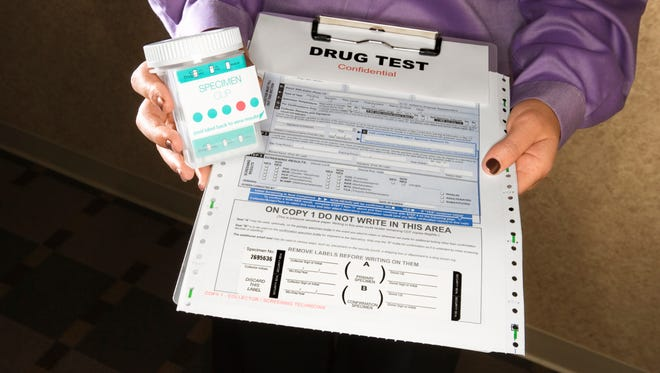FILE --  Woman holding clipboard with drug test