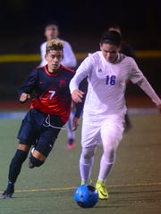 Rio Mesa's Andy Zavala (left) keeps on the heels of Fillmore's Christian Vasquez during a game earlier this season.