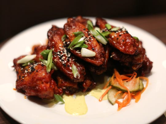Korean BBQ chicken wings are available at the CineBistro in the Cobb Liberty Luxury 15.