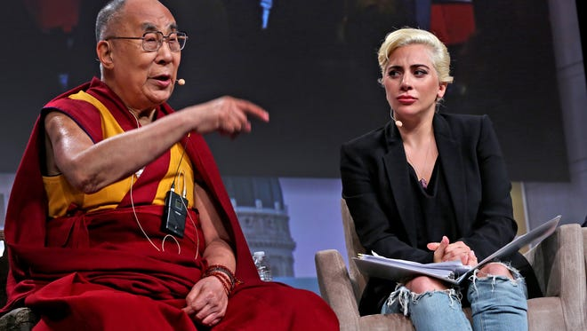 The Dalai Lama is joined by Lady Gaga, right, discussing compassion at The United States Conference of Mayors held at the JW Marriott, Sunday, June 26, 2016.