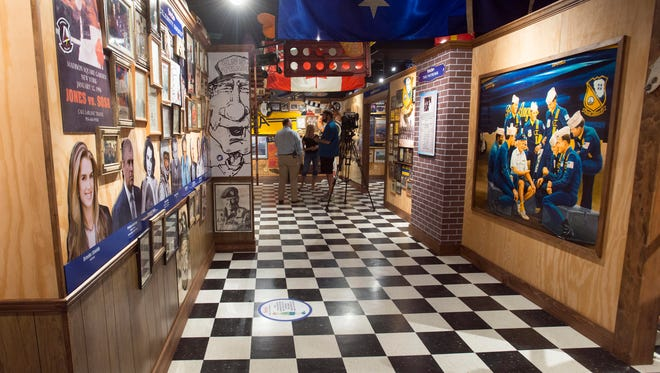 Members of the local media explore the new Trader Jon's exhibit at the T.T. Wentworth, Jr. Florida State Museum in downtwon Pensacola during a media preview Thursday morning.