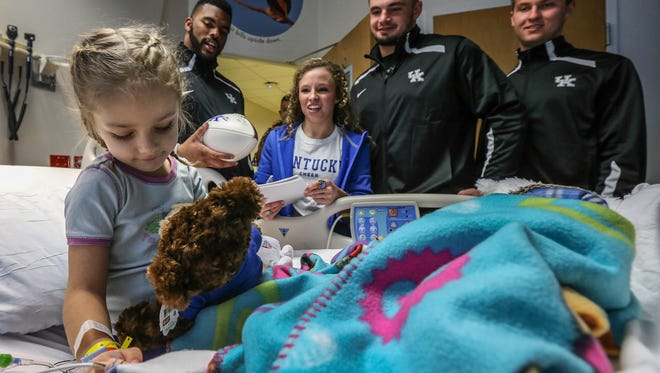 Madeline Johnston got a visit from UK football players and cheerleaders at Wolfson Children's Hospital in Jacksonville on Friday.  Players spent time visiting and delivering autographed footballs, greeting cards and teddy bears.