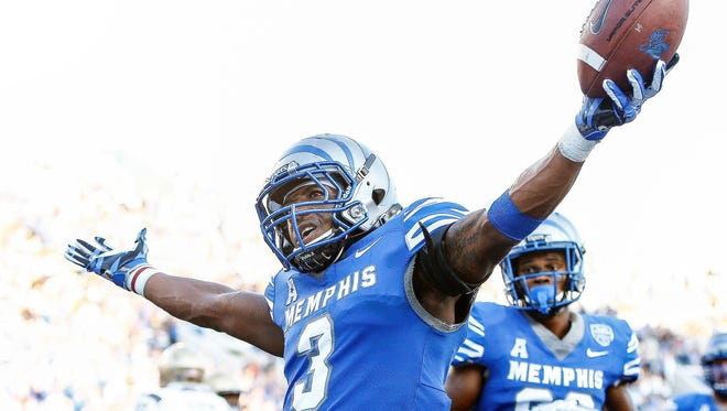 University of Memphis receiver Anthony Miller (middle) celebrates a touchdown catch against the Navy defense during third quarter action at Liberty Bowl Memorial Stadium in Memphis, Tenn., Saturday, October 14, 2017.