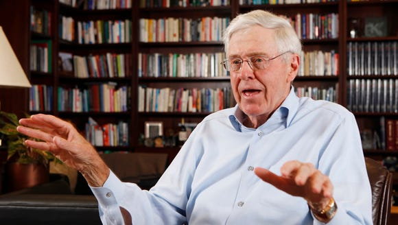 Charles Koch speaks in his office at Koch Industries in Wichita, Kansas in this 2012 photo. The Koch brothers are spending up to $400 million to shape November's midterm elections nationwide.