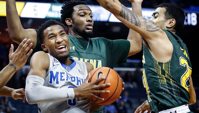 Memphis guard Jeremiah Martin (left) is fouled by a Siena defender during a 2017 game. Martin had surgery to repair a hernia, and is expected to miss 4-6 weeks.