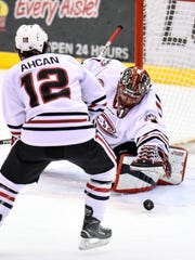 St. Cloud State goaltender Jeff Smith stretches to