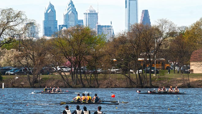 High School crews from around the country row in the Garden State Scholastic Championships Regatta on the Cooper River in Pennsauken in 2015.The Philadelphia skyline looms in the background.