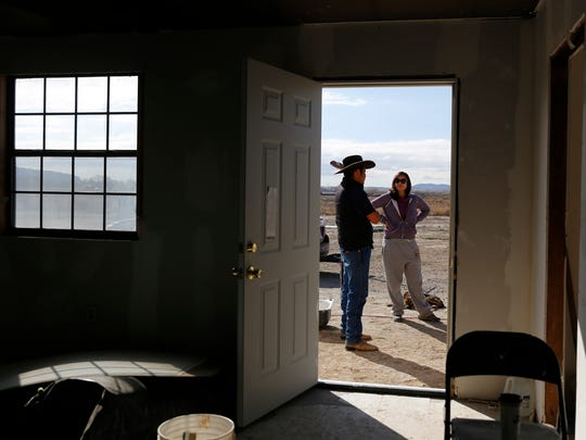 Denny Hale talks with his friend, Darrah Blackwater, on Friday at the Hale residence in Hogback.