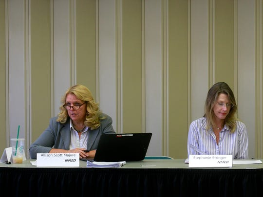 From left, New Mexico Environment Department spokeswoman Allison Scott Majure and Stephanie Stringer, chief of the department's Drinking Water Bureau, participate in the Gold King Mine Citizens' Advisory Committee meeting on Monday at San Juan College in Farmington.
