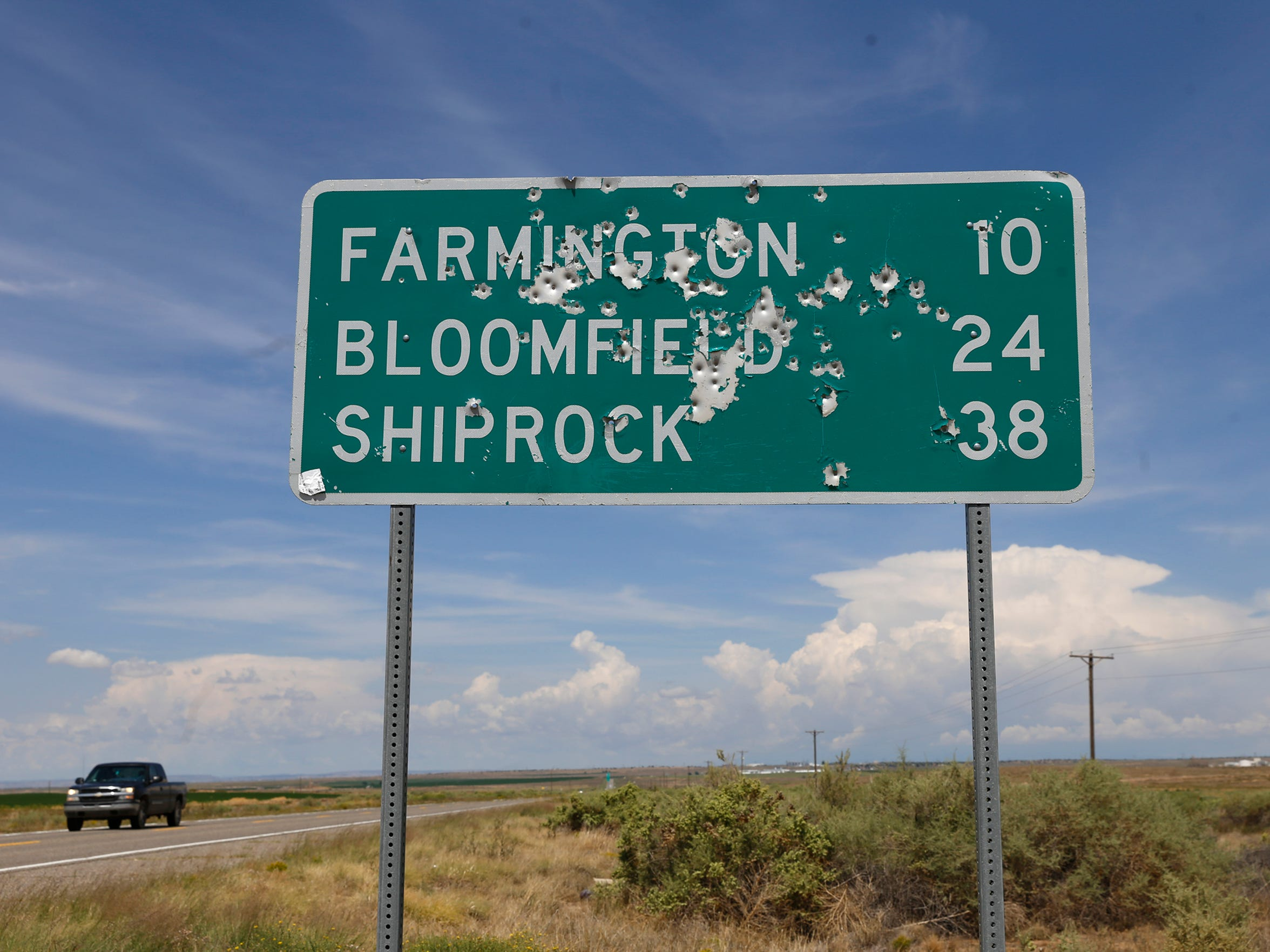A sign on Wednesday is pictured near the border of the Navajo Nation, near mile marker 96 on U.S. Highway 371 south of Farmington.