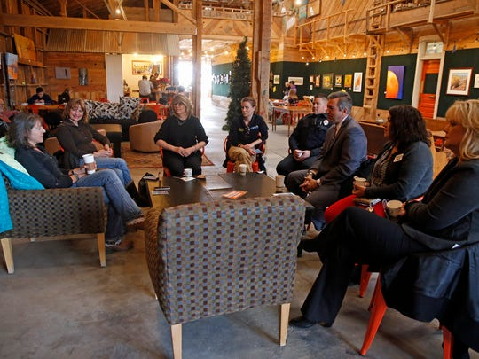 "Jamie Church, left, talks to those gathered for the ""Welcome to Farmington Coffee"" on Wednesday at 302 Espresso in Farmington. Church is the head of the Farmington Branding Alliance Live Team."