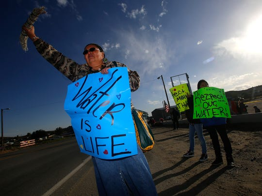 "Dawn Dullknife-Teller protests on Friday, Sept. 21, 2016  about issues concerning AV Water Co.  in Crouch Mesa. Dawn Dullknife-Teller protests on Friday about issues concerning AV Water Co. while holding a ""Water is life"" sign at the intersection of County Roads 390 and 350 in Crouch Mesa."