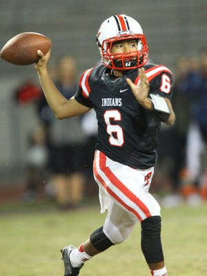 Palm Springs High School's quarterback Jeremy Dotson looks for the open man against Colony during their CIF post-season game against Colony on November 11, 2016.