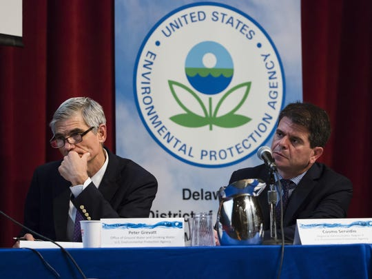 In this July 25, 2018 photo US Environmental Protection Agency's Peter Grevatt, Director of the Office of Ground Water and Drinking Water and Cosmo Servidio, Regional Administrator for the Mid-Atlantic Region, listen to members of the public comment during a PFAS Community Stakeholder Meeting, on in Horsham, Pa. In Horsham and surrounding towns in eastern Pennsylvania, and at other sites around the United States, the foams once used routinely in firefighting training at military bases contained per-and polyfluoroalkyl substances, or PFAS. EPA testing between 2013 and 2015 found significant amounts of PFAS in public water supplies in 33 U.S. states. (AP Photo/Matt Rourke)