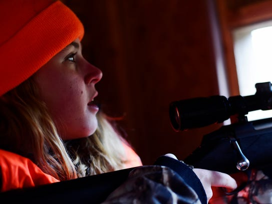 Taylor Howell pauses after shooting a deer from a blind