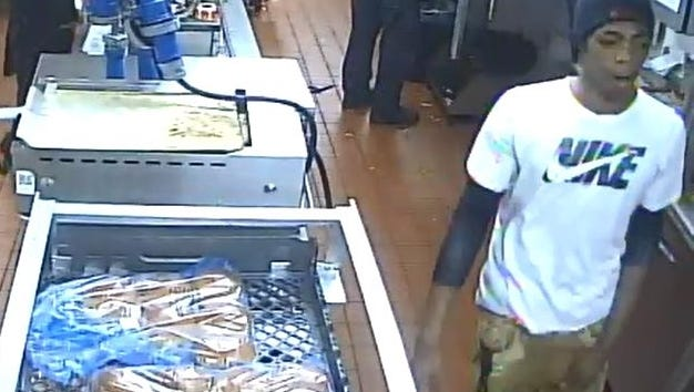 Police are looking for the man in the white shirt, who they say attacked a McDonald's employee at work in April.