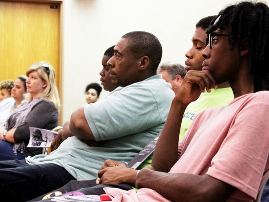 About four dozen gathered for a talk by Bryant Purvis,