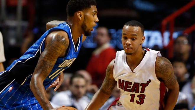 Orlando Magic guard Devyn Marble (11) drives against Miami Heat guard Shabazz Napier (13) in an NBA preseason game Oct. 7.