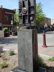 "Steven Maeck of Floral City, Fla., created ""Ancient Game,"" which is part of this year's annual sculpture exhibition in downtown Ames."