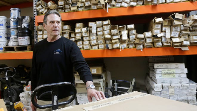 In this March 8, 2016, photo, Mike Patton, CEO of DSB Plus flooring company, is interviewed in his warehouses in Milpitas, Calif. As small companies expand their business into more towns, cities and states, that growth often brings higher expenses from taxes and other government obligations. (AP Photo/Jeff Chiu)