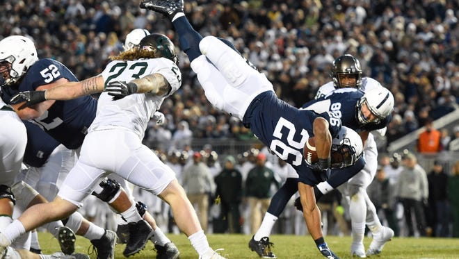 Michigan State held Penn State star Saquon Barkley (26) to just 14 yards rushing on 12 carries and 11 yards receiving on two catches last season.