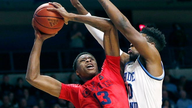 Dayton's Kostas Antetokounmpo goes up to shoot against Rhode Island last season.
