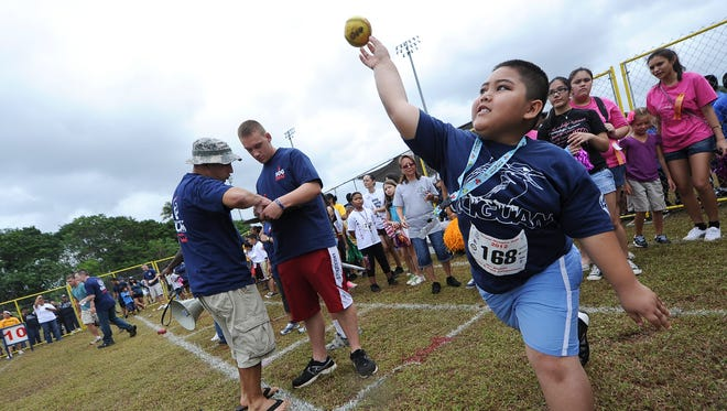 In this March 17, 2012,file photo, Joaquin Perez launches a ball into the air as he competes in the softball throw during the Special Olympics Guam 2012 track and field events at Okkodo High School.