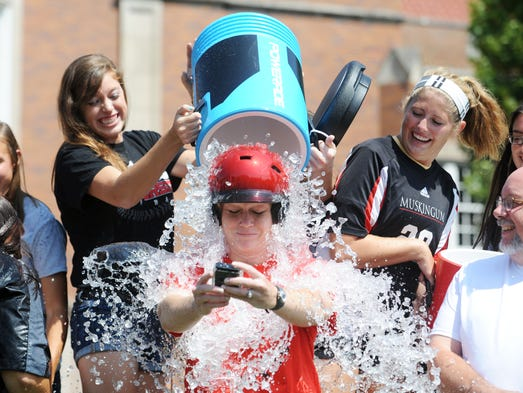 Muskingum University softball coach Kari Winters gets doused with ice water for the ALS Ice Bucket Challenge on Monday. Representatives of the varsity athletic programs at Muskingum were doused for the challenge, but not before challenging the other schools of the Ohio Athletic Conference office and the nine other athletic departments in the league.