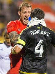 Columbus Crew SC goalkeeper Steve Clark celebrates his stop of a penalty kick with Crew defender Michael Parkhurst (4) against the Real Salt Lake on May 28.