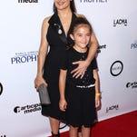 Salma Hayek attends a screening of 'Kahlil Gibran's The Prophet' with her daughter, Valentina Paloma Pinault. The animated film was a labor of love for Hayek. Her daughter, an early critic, voices a character in the French version.