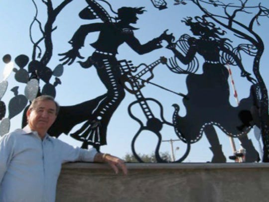 "Tejano artist Servando Hinojosa in front of ""Alicia"