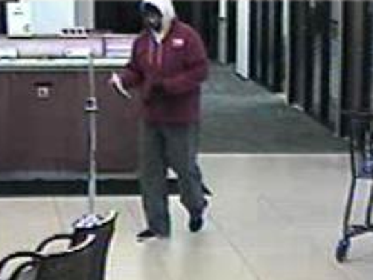 Bank surveillance photo of a robbery suspect at Associated