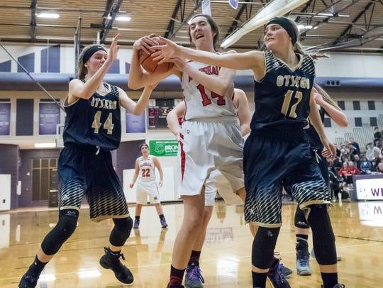 Marshall's Georgianna Pratley (14) grabs the rebound