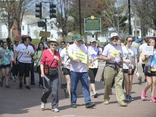 A horde of people marched down the Church Street Marketplace and around Burlington on Sunday to different shelters as part of the COTS Walk, an annual fundraiser and event for homelessness awareness.