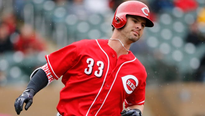 Cincinnati Reds left fielder Jesse Winker runs for first before being thrown out in the top of the fifth inning of the MLB Spring Training game between the Arizona Diamondbacks and the Cincinnati Reds at Salt River Fields in Scottsdale, Ariz., on Monday, Feb. 27, 2017.