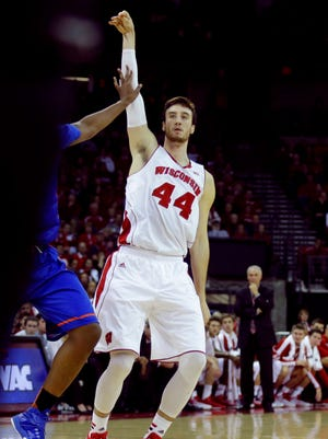 Wisconsin senior Frank Kaminsky hits a 3-pointer during the first half against Boise State at the Kohl Center.