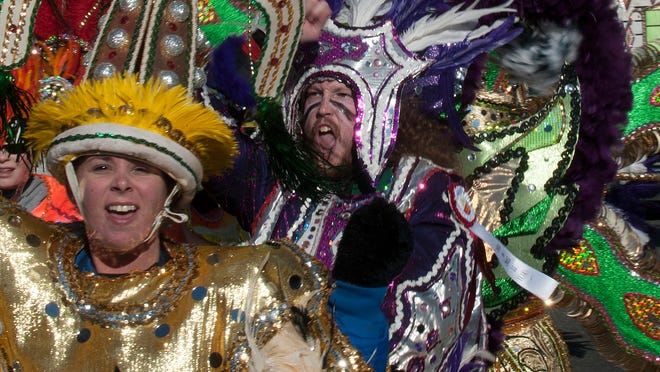 Mummers parade down Broad Street during the 2015 Mummers Parade in Philadelphia.