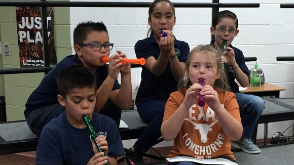 Jose H. Damian Elementary School students practice playing recorders in a music class on Oct. 15.