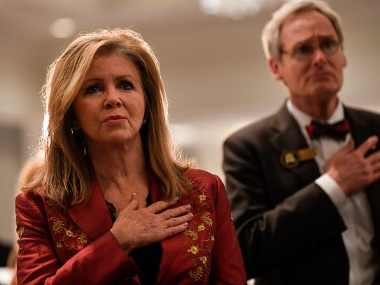 U.S. Senate candidate Marsha Blackburn sings the national