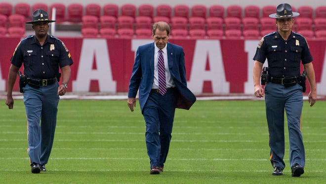 Alabama head coach Nick Saban walks the field after the team arrives before the Mercer Game at Bryant Denny Stadium in Tuscaloosa, Ala. on Saturday November 18, 2017. (Mickey Welsh / Montgomery Advertiser)