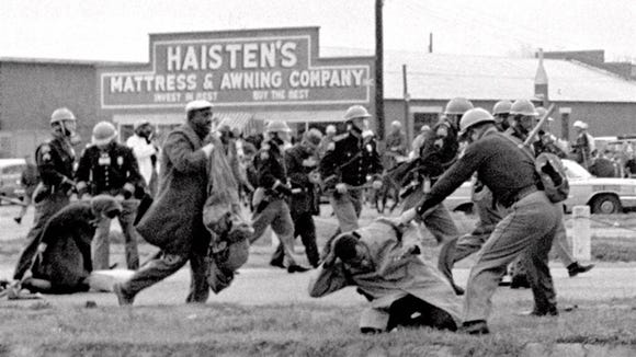"Alabama state troopers beat John Lewis and other marchers in Selma in what becomes known as ""Bloody Sunday."""