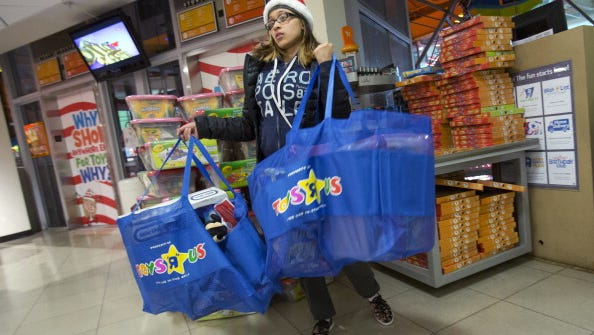 A shopper at the Toys 'R' Us store in Times Square on Nov. 22, 2012, in New York.