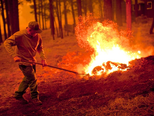 A resident of Alpine attacked a spot fire in the Chapache
