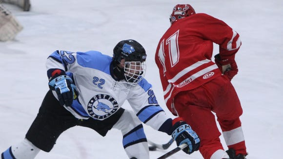 North Rockland's Chris Hilliard skates past Suffern's