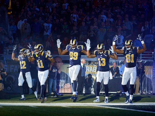 Rams players put their hands up to show support for