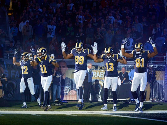Rams players put their hands up to show support for Michael Brown before a game in 2014 in St. Louis.