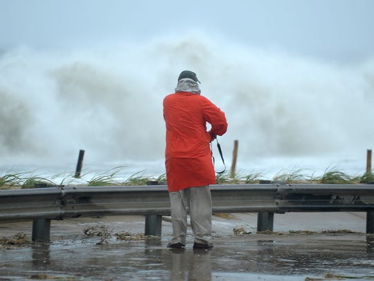Water starts to come over the seawall at Surf Avenue in Rehoboth Beach as Hurricane Sandy begins to lash the Delaware Coast.