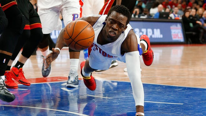 Detroit Pistons guard Reggie Jackson dives for a loose ball against the Miami Heat in Auburn Hills on April 4, 2015.