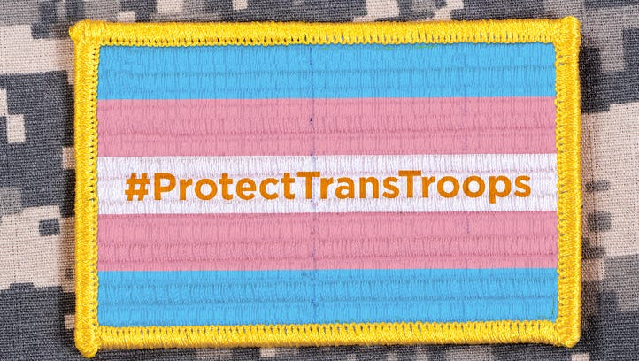 A badge supporting the open military service of transgender