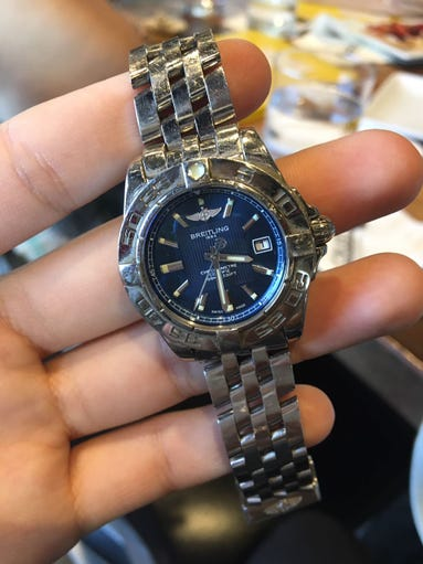 A Breitling watch belonging to Merchandising Manager